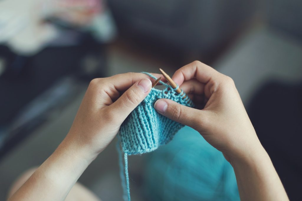 Person's hands knitting